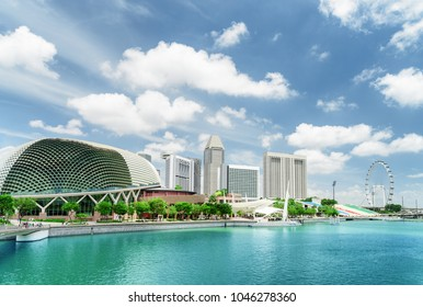 Scenic view of modern buildings and Marina Bay with azure water in Singapore. Beautiful summer cityscape. Singapore skyline. Singapore is a popular tourist destination of Asia.