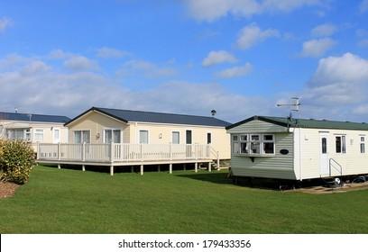 Scenic view of modern trailer of caravan park in summer.