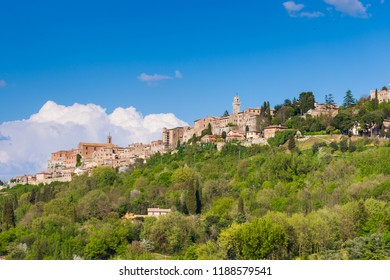 A scenic view of Montepulciano hill town with greenery in early spring, Tuscany, Italy