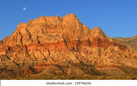 Scenic view of the moon shining over Red Rock Canyon, Nevada at sunrise