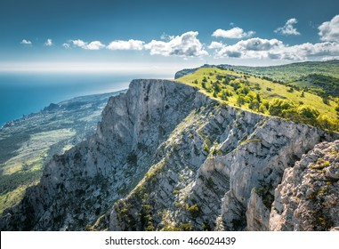Scenic view of Mount Ai-Petri over the Black Sea in summer, Crimea, Russia. It is one of the highest mountains in Crimea and tourist attraction. Beautiful panorama of Crimea coast on sunny day.