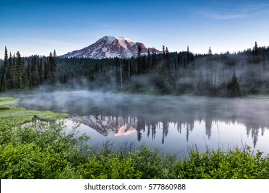 Scenic view of Mount Rainier reflected across the reflection lakes at sunrise