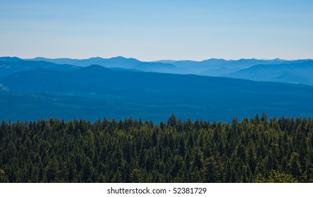 Scenic view of mountains with forest in foreground