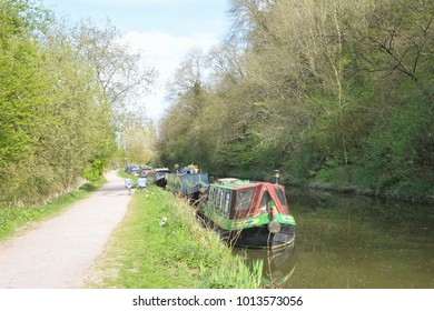 Scenic View of Narrow Boats and a Tow Path on a Canal - Namely the Kennet and Avon Canal as it Runs Near the Landmark City of Bath in Somerset England