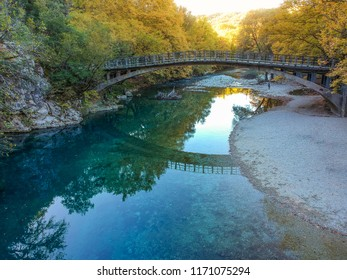 Scenic view of the natural beauty at the famous voidomatis river passing from the National park of Vikos and a beautiful bridge near Aristi village in Autumn. Epirus, Greece, Europe