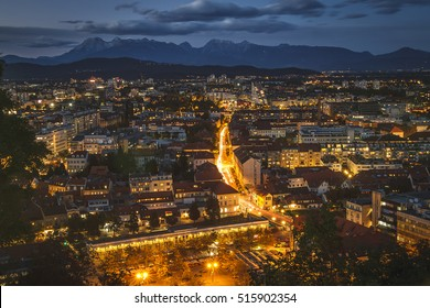 Scenic view of night Ljubljana with Karawanks and Alps mountains in the background. Taken from Ljubljana Castle, Ljubljana, Slovenia.