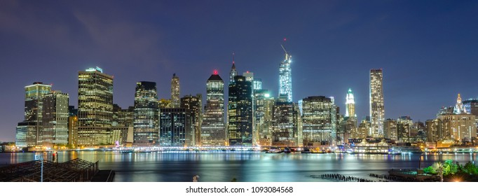 Scenic view at night of modern skyscrapers in lower Manhattan, New York City, USA. Concept for business, finance, real estate