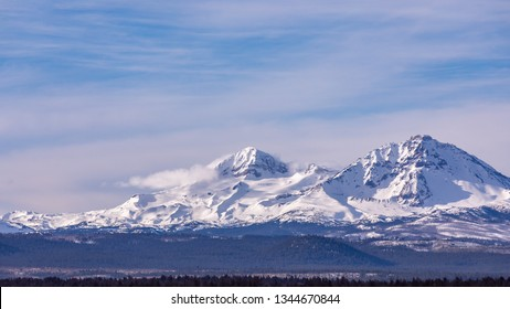 Scenic view of North and South Sister mountains in Central Oregon from US highway 20.