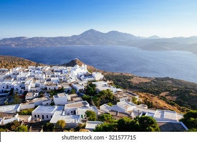 Scenic view of ocean and traditional Greek village Plaka on Milos island, Greece