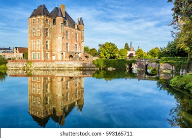 Scenic view of the old castle in Loire Valley, France. French chateau with a mirror reflection in water. Panorama of a beautiful lake with vintage mansion. Loire Valley is UNESCO World Heritage Site.