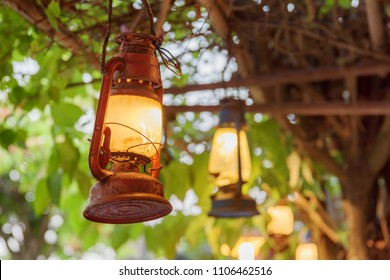 Scenic view of old street lights on green foliage background. Vintage style lighting. Amazing decor.