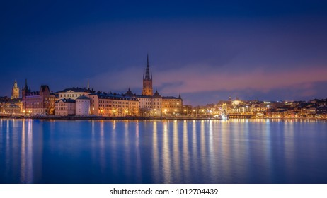 Scenic view of the old town by night with Riddarholmen, Gamla Stan and Sodermalm islands, Stockholm, Sweden