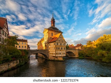 Scenic view of Old Town Hall (Altes Rathaus) of Bamberg, Germany under moving picturesque clouds at sunny autumn day. UNESCO World Heritage Site.
