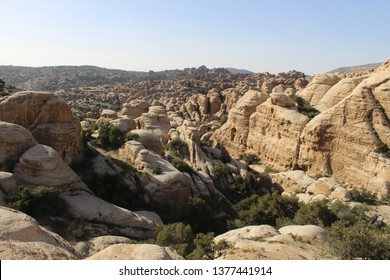 Scenic view on the beautiful rock formations with a lot of green plants and trees in Wadi Dana, Dana Biosphere Reserve, Jordan
