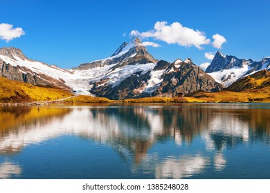 Scenic view on Bernese range above Bachalpsee lake. Popular peaks Eiger, Jungfrau and Faulhorn. Switzerland alps, Grindelwald valley