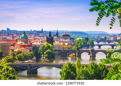 Scenic view on bridges over Vltava river in Prague city. Charles bridge (Karluv Most) and old historical buildings, Czech Republic.