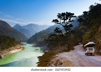 Scenic view on Ganges river with four wheel drive car goes to rafting on the Ganges river in Rishikesh, Uttarakhand, India