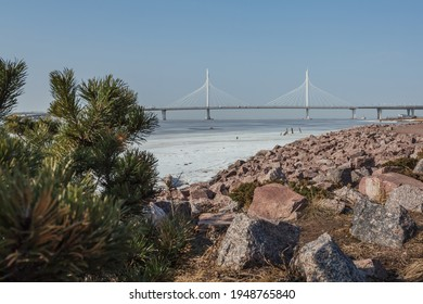 Scenic view on the icy Finnish Gulf and a beautiful bridge by the horizon.