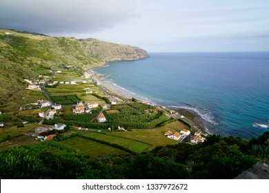 Scenic view on the little village on the sea of Vila do Porto on Santa Maria Island (Azores, Portugal) with vineyards, banana trees, typical houses and the beach named Praia Formosa