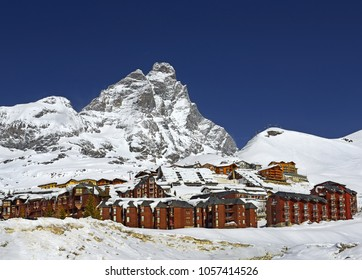 Scenic view on Matterhorn peak - Monte Cervino from Breuil-Cervinia. Mountain situated on the border between Switzerland and Italy, over the Swiss Zermatt and the Italian town of Breuil-Cervinia.