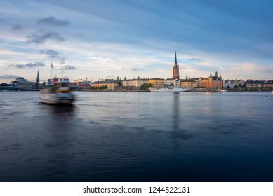 Scenic view on on Stockholm, Sweden. Old city of Stockholm at sunset during blue hour. Ferry leaves the mooring.