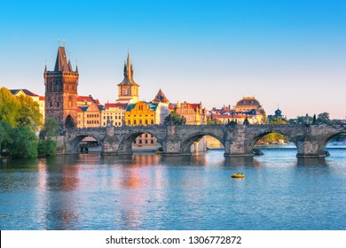 Scenic view on Vltava rive, Charles bridge and historical center of Prague, buildings and landmarks of old town at sunset, Prague, Czech Republic