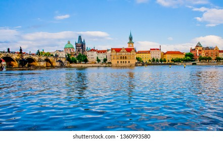 Scenic view on Vltava river, Charles bridge and historical center of Prague, buildings and landmarks of old town at sunset, Prague, Czech Republic.