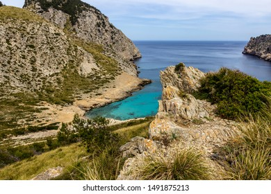 Scenic view on wonderful  rocky bay Cala Figuera on balearic island Mallorca, Spain on a sunny day with clear turquoise water in different colors