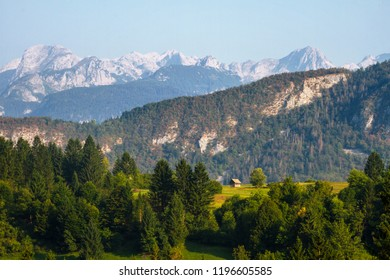 Scenic view on the wooden hut and peaks of the mountains of Triglav National Park. Slovenia, Triglav region. Slovenian Alps. Julian Alps in summer.