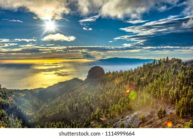 Scenic view over forest, mountains and sea in sunflare, Tenerife, Canary islands