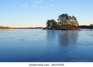 Scenic view over frozen lake in sunset