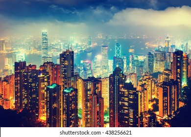 Scenic view over Hong Kong, China, by night. Nighttime skyline with illuminated skyscrapers seen from Victoria Peak.