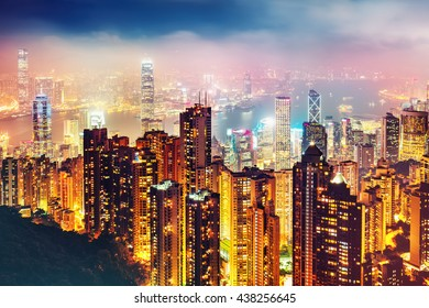 Scenic view over Victoria Harbor in Hong Kong, China, by night. Colorful travel background with illuminated skyscrapers seen from Victoria Peak.