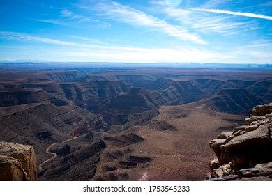 Scenic view overlooking canyons with Monument Valley in the distance