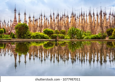 Scenic view of pagodas in Kakku with water reflection, Myanmar, Asia