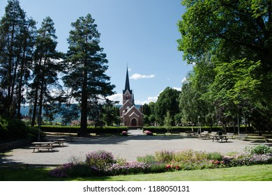 scenic view of park with trees and building in Lillehammer, Oppland, Norway
