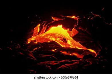 "Scenic view of a part of a lava flow in the dark, the hot lava shows up in yellow and red shades - Location: Hawaii, Big Island, volcano ""Kilauea"""
