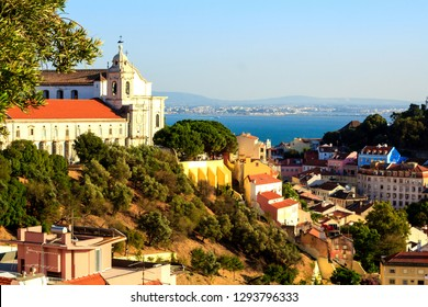 Scenic view at the picturesque green hill with the church and the Tagus river on the background in Graca, Lisbon, Portugal.