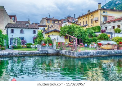 Scenic view with picturesque houses on the waterfront in the town of Salo, Lake Garda, Italy