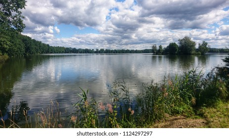 Scenic view of pond against dramatic sky with clouds in South Bohemia, near Trebon city. One of the many ponds near Trebon city in Trebon region.