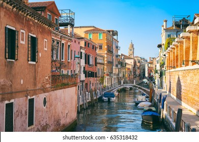 Scenic view of a quiet and quaint canal in Venice, Italy with typical colorful Italian architecture