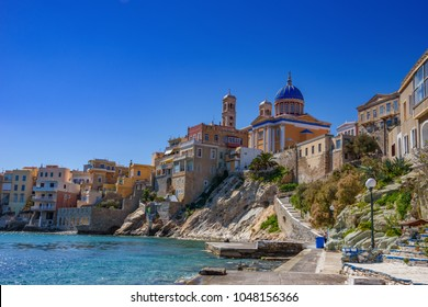Scenic view of the residential area called Vaporia in Ermoupolis town, Syros, Greece. It is an old aristocratic district of Syros island. Centered the church of Saint Nicolaos Cyclades, Greece, Europe