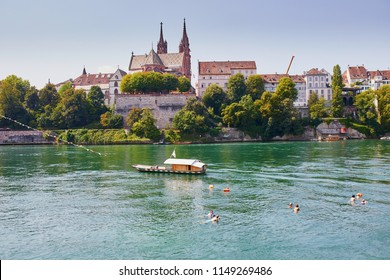 Scenic view of Rhine embankment with ferry boat crossing the river in Basel, Switzerland