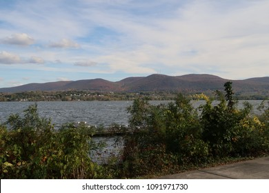 Scenic view of a river with hills on the other side.
