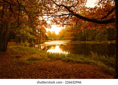 Scenic view of a river landscape at sunrise