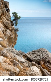 Scenic view of rock cliff and sea, Crete, Greece