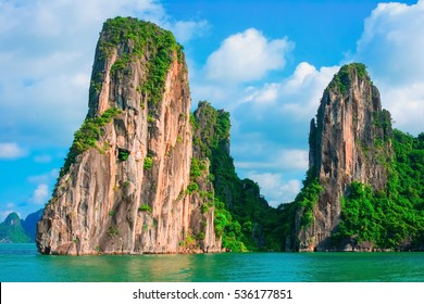 Scenic view of rock island in Halong Bay, Vietnam, Southeast Asia. UNESCO World Heritage Site. Mountain islands at Ha Long Bay. Beautiful landscape Popular asian landmark famous destination of Vietnam