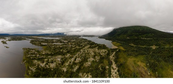 Scenic View of Rocky Islands from Above surrounded by Mountains and Lakes. Aerial Drone Shot. Taken by Klondike Highway, Northern British Columbia, Canada.