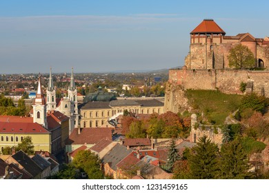 Scenic view of royal castle, roofs and towers in Watertown (old town under castle) in Esztergom, Hungary at sunny day. Esztergom is popular destination for tourists staying in Budapest