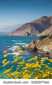 Scenic view of rugged coastline of Big Sur with Santa Lucia Mountains and Big Creek Bridge along famous Highway 1 in beautiful golden evening light at sunset in summer, California Central Coast, USA
